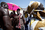18 december 2010 - Juba, Southern Sudan - A member of the Dinka tribe from Bor, Jonglei State before the final of South Sudan's first commercial wrestling league between his tribe and the Mundari wrestlers from Central Equatoria State at Juba Stadium. The matches attracted large numbers of spectators who sang, played drums and danced in support of their favorite wrestlers. The match organizers hoped that the traditional sport would bring together South Sudan's many different tribes. Photo credit: Benedicte Desrus