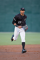 Kannapolis Intimidators center fielder Joel Booker (23) jogs off the field between innings of the game against the Lakewood BlueClaws at Kannapolis Intimidators Stadium on April 6, 2017 in Kannapolis, North Carolina.  The BlueClaws defeated the Intimidators 7-5.  (Brian Westerholt/Four Seam Images)