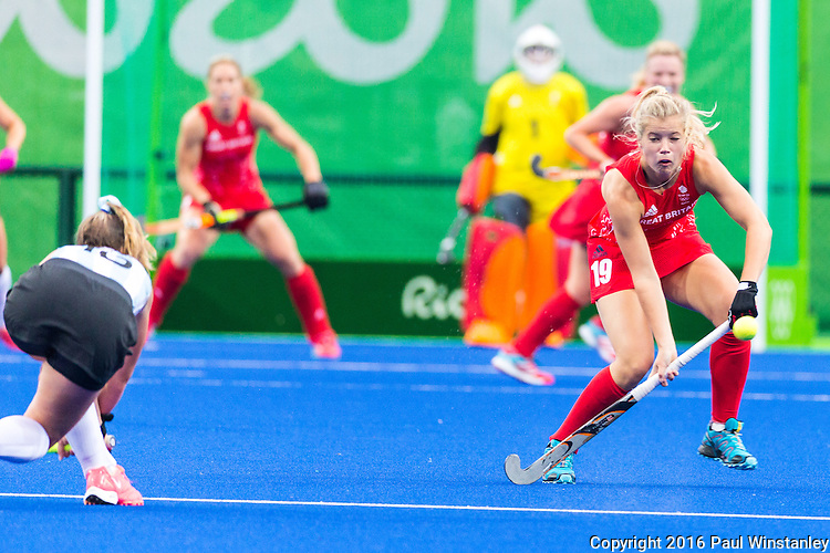 Florencia Habif #16 of Argentina hits the ball past Sophie Bray #19 of Great Britain during Argentina vs Great Britain in women's Pool B game  at the Rio 2016 Olympics at the Olympic Hockey Centre in Rio de Janeiro, Brazil.