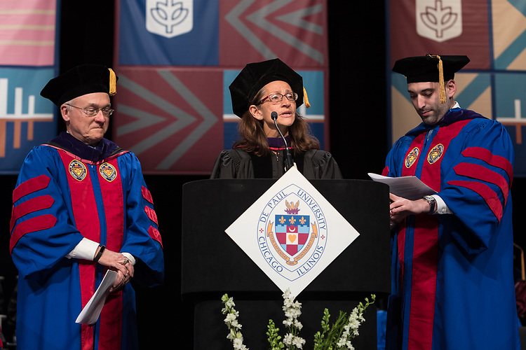 Jennifer Rosato Perea, dean of the College of Law, center, inducts the graduating students into the Alumni Association with George M. Pearce, Class of 1979, left, and Corey Celt, student speaker, at the DePaul University College of Law commencement ceremony, Sunday, May 14, 2017. The ceremony was held at the Rosemont Theatre in Rosemont, IL., where some 240 students received their Juris Doctors or Master of Laws degrees. (DePaul University/Jeff Carrion)