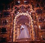 A294KC Virgin Mary Madonna statue in gilded glass case interior roman catholic church Mexico