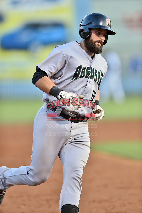 Augusta GreenJackets catcher Matt Winn (16) runs to third base during a game against the Asheville Tourists at McCormick Field on August 5, 2016 in Asheville, North Carolina. The Tourists defeated the GreenJackets 7-6. (Tony Farlow/Four Seam Images)