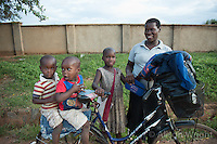 N. Uganda, Kitgum District. Family on their bicycle.