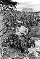 A member of the community pauses from working on his plot of land. Community of Nueva Esperanza, El Salvador, 1999.