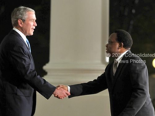 Washington, D.C. - November 14, 2008 -- United States President George W. Bush welcomes President Kgalema Motlanthe of South Africa to the Summit on Financial Markets and the World Economy on the North Portico of the White House in Washington, D.C. on Friday, November 14, 2008..Credit: Ron Sachs / Pool via CNP