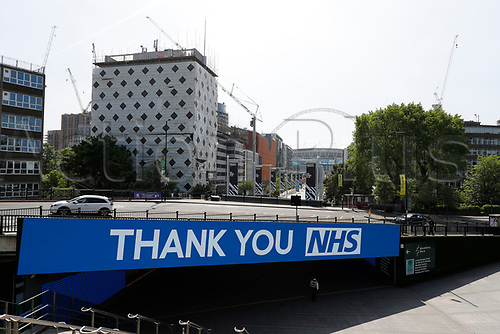 9th May 2020, Wembley Stadium, London, England; Stadium deserted during the lockdown for the Covid-19 virus; A sign thanking the NHS for their efforts with the Wembley arch in the background