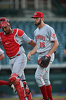 AZL Reds starting pitcher Ryan Hendrix (36) walks off the field with Jose Tello (40) between innings of a rehab assignment in an Arizona League game against the AZL Cubs 2 on July 23, 2019 at Sloan Park in Mesa, Arizona. AZL Cubs 2 defeated the AZL Reds 5-3. (Zachary Lucy/Four Seam Images)