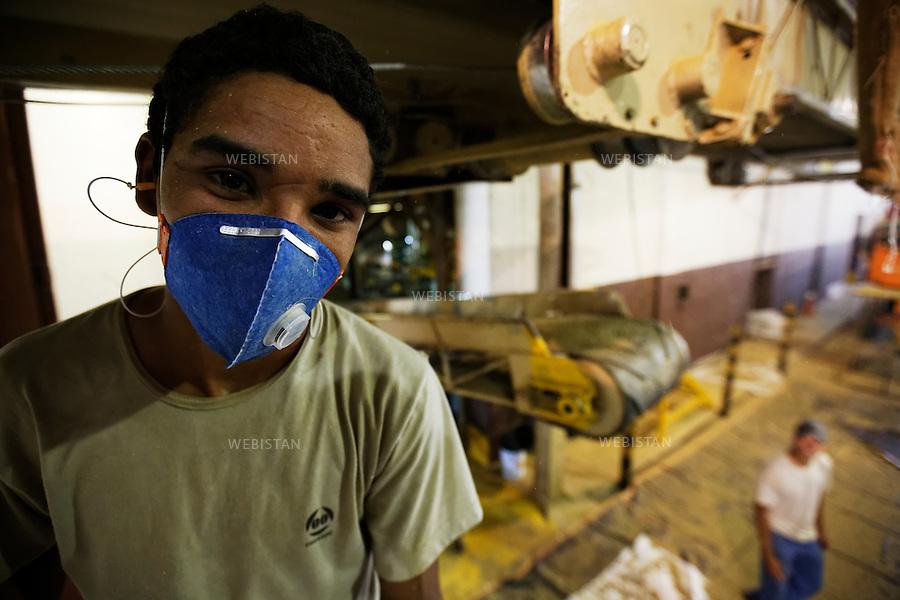 Bresil, etat Minas Gerais, Guaxupe, entrepot Cooxupe, 31 octobre 2012.<br /> <br /> Cooxupe est l&rsquo;une des plus grosses cooperatives bresiliennes de cafe. Elle a signe un partenariat avec Nespresso dans le cadre du Programme AAA. Elle dispose de plusieurs sites dont celui de Guaxupe qui s'est dote, en 2008, d'un laboratoire ultra-moderne d'analyse du cafe.<br /> Portrait d'Alfredo Afim dans la salle des machines.<br /> Reportage les Chants de cafe_soul of coffee, realise sur les acteurs terrain du programme de developpement durable Triple AAA de Nespresso.<br /> <br /> <br /> Brazil, Minas Gerais, Guaxupe, Cooxupe Warehouse, October 31, 2012 <br /> <br /> Cooxupe, one of the largest coffee cooperatives in Brazil, signed a partnership with Nespresso AAA Program. Cooxupe has several sites, including one in Guaxupe, which in 2008 acquired a state-of-the-art laboratory to analyze coffee. <br /> A portrait of Alfredo Afim in the engine room. <br /> Assignment: les Chants de cafe_ Soul of Coffee, implemented on the fields of Nespresso&rsquo;s AAA Sustainable Quality Program.