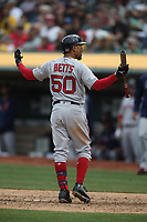 OAKLAND, CA - APRIL 4:  Mookie Betts #50 of the Boston Red Sox reacts after striking out against the Oakland Athletics during the game at the Oakland Coliseum on Thursday, April 4, 2019 in Oakland, California. (Photo by Brad Mangin)