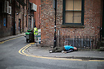 © Joel Goodman - 07973 332324 . 06/04/2017 . Manchester , UK . A man lies collapsed on the pavement on Newton Street . An epidemic of abuse of the drug spice by some of Manchester's homeless population , in plain sight , is causing users to experience psychosis and a zombie-like state and is daily being witnessed in the Piccadilly Gardens area of Manchester , drawing large resource from paramedic services in the city centre . Photo credit : Joel Goodman