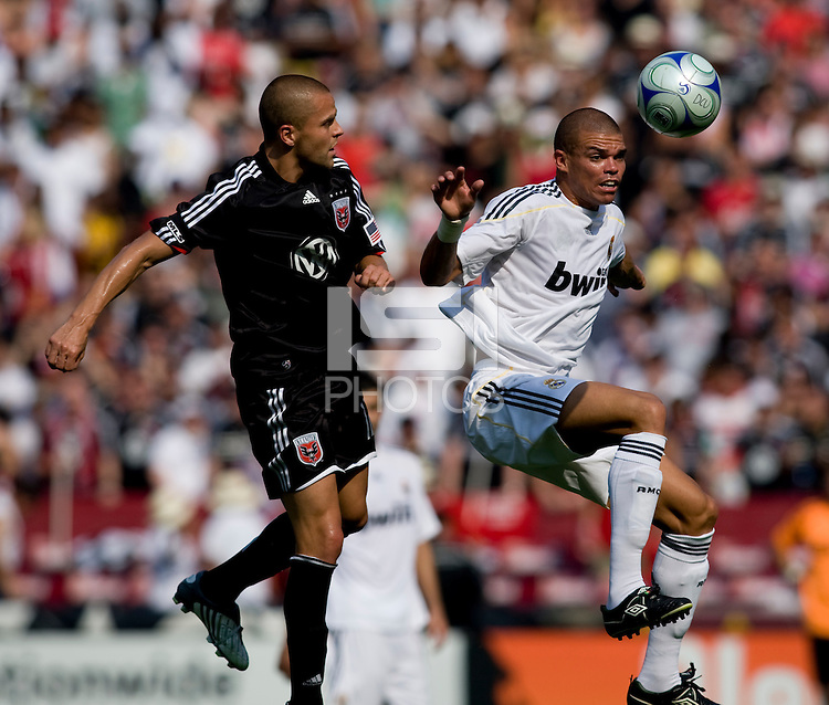 Real Madrid defender (3) Pepe goes up for a header with DC United midfielder (12) Danny Szetela during their friendly at FedEx Field in Landover, Maryland.  Real Madrid defeated DC United, 3-0.