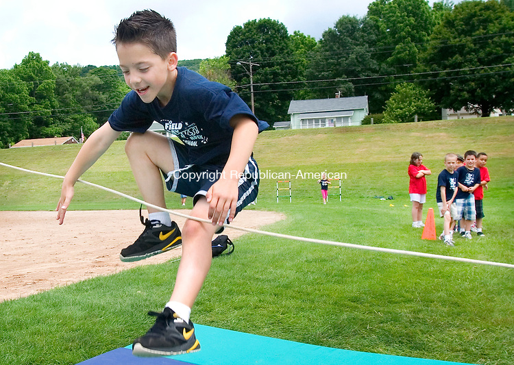 THOMASTON, CT. 15 June 2010-061510SV02--Derek Young, 7, tries the high jump during field day at Black Rock School in Thomaston Monday. The whole school participated about 362 students.<br /> Steven Valenti Republican-American