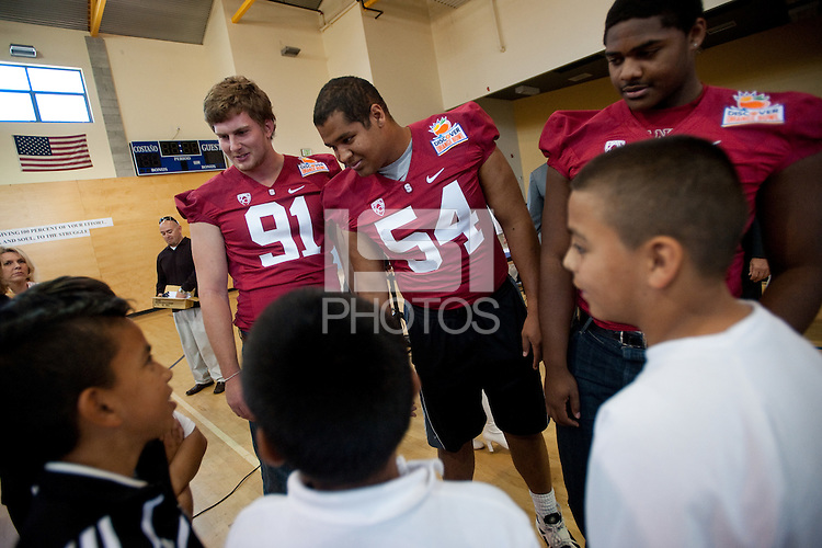 EAST PALO ALTO, CA - JUNE 6: Stanford athletes meet younger football enthusiasts after Stanford announces a Summer partnership with the San Francisco 49ers Academy benefitting underprivileged youth in East Palo Alto.