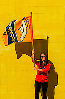 A Denver Broncos fan waves a team flag and shows her team spirit after the team's Super Bowl 50 win, Littleton, Colorado USA.