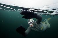 Steinar Schjager freediving under the ice at Lutvann lake,outside Oslo, Norway. Photo: Fredrik Naumann/Felix Features