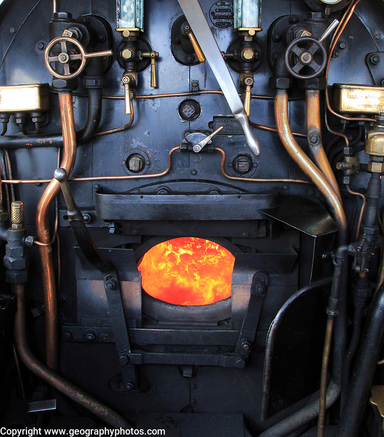 Heritage steam railway, Sheringham station, North Norfolk Railway, England, UK onboard steam engine with coal fire