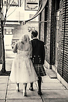 Couple walking down a street just after their wedding