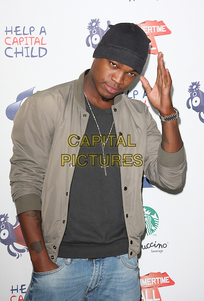 NE-YO (Shaffer Chimere Smith, Jr.).The Capital FM Summertime Ball, Wembley Stadium, London, England..June 12th, 2011.half length jeans denim black top grey gray jacket beanie hat hand in pocket waving .CAP/ROS.©Steve Ross/Capital Pictures