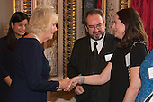 London, Uk. 15/10/2015. HRH The Duchess of Cornwall is introduced to the parents of Senior Winner Paraschos Cant. The Duchess of Cornwall on behalf of Her Majesty The Queen, Patron of The Royal Commonwealth Society, holds a reception for winners of The Queen's Commonwealth Essay Competition at Buckingham Palace. The Queen's Commonwealth Essay Competition was founded in 1883 and is the world's oldest international schools' writing contest. This year's competition, sponsored by Cambridge University Press, received more than 13,000 entries from over 600 schools in 49 Commonwealth countries and territories. The Duchess of Cornwall hands out awards to young writers who have travelled from across the Commonwealth to attend the reception. This year's winners have come from Cyprus, Botswana, The Cayman Islands and as far away as Tristan da Cunha - over 9000km away.
