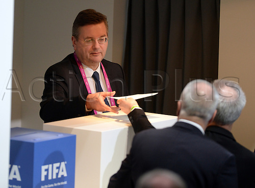 Reinhard Grindel, treasurer of the German Football Association DFB, casts his vote into a ballot during the Extraordinary FIFA Congress 2016 held at the Hallenstadion in Zurich, Switzerland, 26 February 2016. The Extraordinary FIFA Congress is being held in order to vote on the proposals for amendments to the FIFA Statutes and choose the new FIFA President. PHOTO: PATRICK SEEGER/dpa