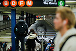 NEW YORK - APRIL 20: A man walks at a subway station while images of David Bowie are displayed as art installations on April 20, 2018 in New York, NY. A Bowie exhibition inside Broadway-Lafayette subway station features fan-made works of Bowie-themed art paying tribute to one of rock's most iconic figures in New York City. The Bowie installation at Broadway-Lafayette is a collaboration between Spotify and the Brooklyn Museum. (Photo by Eduardo MunozAlvarez/VIEWpress)
