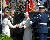 Washington, DC - April 15, 2008 -- Pope Benedict XVI , right, is greeted by first lady Laura Bush, left, and United States President George W. Bush, center as he arrives at the White House in Washington, D.C. on Wednesday, April 16, 2008.  .Credit: Ron Sachs / CNP.(RESTRICTION: NO New York or New Jersey Newspapers or newspapers within a 75 mile radius of New York City)