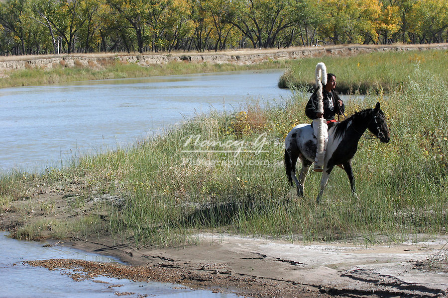 A Native American Sioux Indian on horseback who just crossed a river in South Dakota