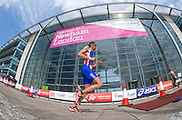 31 JUL 2011 - LONDON, GBR - Stuart Hayes passes Building 1000 on the run of the Elite Men's race during the Virgin Active London Triathlon (PHOTO (C) NIGEL FARROW)