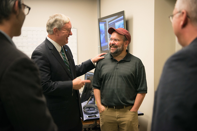President Nellis talks with Associate Professor Eric Williams during a tour of the Grid Lab in Scripps Hall.