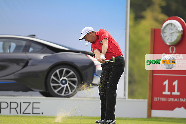 Peter LAWRIE (IRL) tees off the 11th tee during Thursday's Round 1 of the 2014 Omega European Masters held at the Crans Montana Golf Club, Crans-sur-Sierre, Switzerland.: Picture Eoin Clarke, www.golffile.ie: 4th September 2014