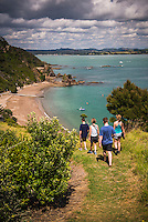 Family walking on Tapeka Point, Russell, Northland Region, North Island, New Zealand