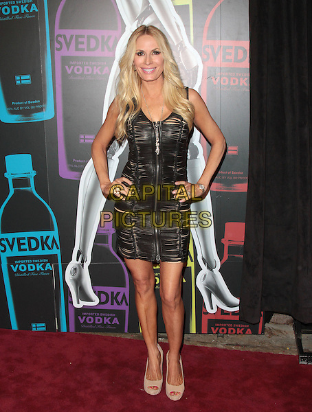 Peggy Tanous.The Second Annual 'Night of a Billion Reality Stars' Bash held at the Supperclub, Los Angeles, California, USA, 29th March 2012..full length dress hands on hips leather  zip  black .CAP/ADM/SLP/JO.©James Orken/Starlitepics/AdMedia/Capital Pictures.