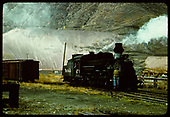 3/4 view of D&amp;RGW #473 with workman standing on front of engine.  Smelter dump at Durango is in background.<br /> D&amp;RGW  Durango, CO
