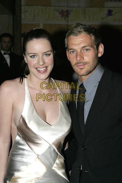 MICHELLE RYAN & GUEST.Leaving the After Party for the Pioneer British Academy Television Awards (TV BAFTA's), Grosvenor House Hotel, .London, April 17th 2005..half length cream satin halterneck beige dress.Ref: AH.www.capitalpictures.com.sales@capitalpictures.com.©Adam Houghton/Capital Pictures.