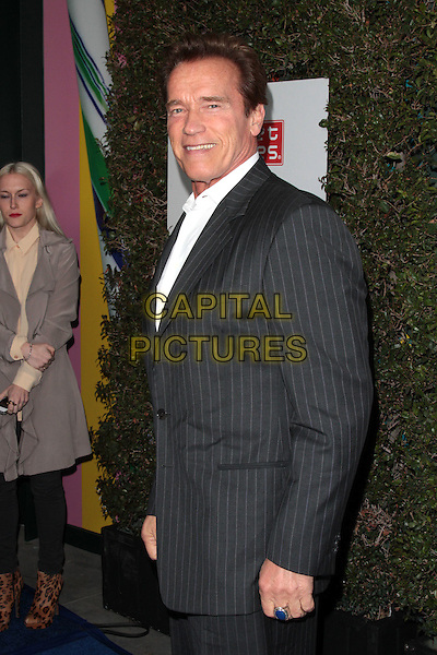 Arnold Schwarzenegger.The Grand Opening of Planet Dailies and Mixology 101 held at the Grove at the Farmers Market, Los Angeles, California, USA..5th April 2012.half length suit shirt side black white.CAP/ADM/SP/JO.©James Orken/Starlitepics/AdMedia/Capital Pictures.