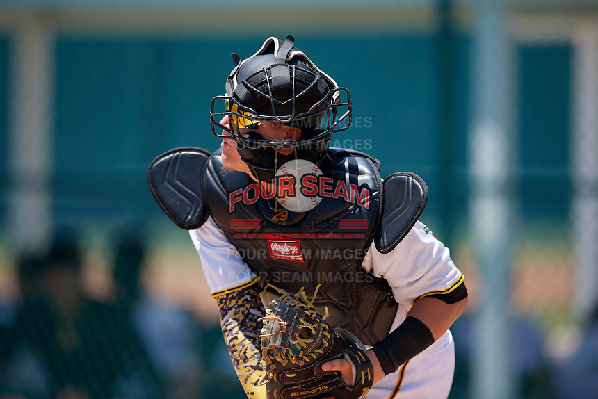 GCL Pirates catcher Daniel Angulo (27) throws down to second base during a Gulf Coast League game against the GCL Braves on July 30, 2019 at Pirate City in Bradenton, Florida.  GCL Braves defeated the GCL Pirates 10-4.  (Mike Janes/Four Seam Images)