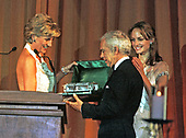Washington, DC -September 24, 1996 - Princess Diana presents an award to Ralph Lauren at the benefit for the Nina Hyde Center for Breast Cancer Research in Washington, DC on September 24, 1996.<br /> Credit: Richard Ellis / Pool via CNP