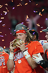 Clemson Tigers quarterback Trevor Lawrence (16) kisses the trophy after the Fiesta Bowl game against the Ohio State Buckeyes on Saturday, Dec 28, 2019 in Glendale, Ariz.  (Gene Lower via AP)