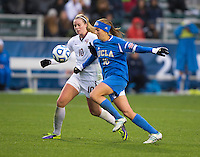 Sarah Killion (16) of UCLA tries to break past B. Thorvaldsdottir (10) of Florida State during the NCAA Women's College Cup finals at WakeMed Soccer Park in Cary, NC.  UCLA defeated Florida State, 1-0, in overtime.