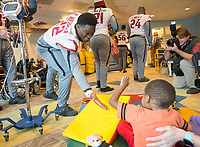 NWA Democrat-Gazette/JASON IVESTER<br /> Arkansas running back Rawleigh Williams gets a high five from Kah'Lei Graham, 3, of Aberdeen, N.C., a patient at Levine Children's Hosptial, on Tuesday, Dec. 27, 2016, at the hosptial in Charlotte, N.C.
