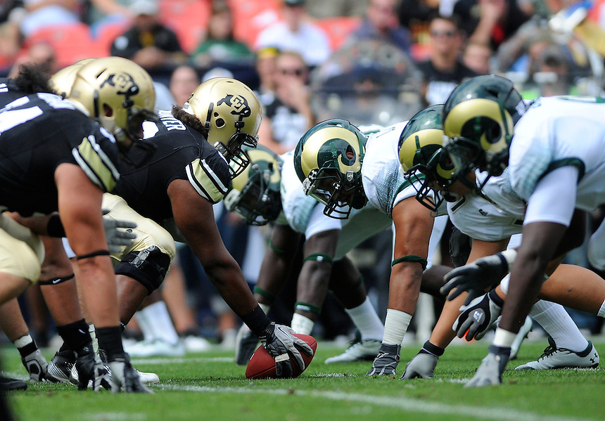 SEPTEMBER 17, 2011:     The Colorado Buffaloes offensive line and the Colorado State Rams defensive line line up during an inter-conference game between the Colorado State Rams and the University of Colorado Buffaloes at Sports Authority Field at Mile High Field in Denver, Colorado. The Buffaloes led 14-7 at halftime*****For editorial use only*****