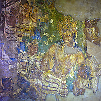 "Ajanta, a UNESCO world heritage site, is famous for its Buddhist rock-cut cave temples and monasteries with their extraordinary wall paintings. The temples are hollowed out of granite cliffs on the inner side of a 20-meter ravine in the Wagurna River valley, 105 km northeast of Aurangabad, at a site of great scenic beauty. About 30 caves were excavated between the 1st century BCE and the 7th century CE and are of two types, caityas (""sanctuaries"") and viharas (""monasteries""). Although the sculpture, particularly the rich ornamentation of the caitya pillars, is noteworthy, it is the fresco-type paintings that are the chief interest of Ajanta. These paintings depict colorful Buddhist legends and divinities with an exuberance and vitality that is unsurpassed in Indian art.†[Adapted from Encyclopedia Britannica] Cave 10 in Ajanta Caves contains the oldest Indian paintings of historical period, made around the 1st century BC.<br />