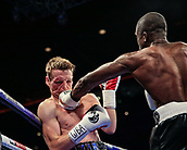 30th September 2017, Echo Arena, Liverpool, England; Matchroom Boxing, Eliminator for WBA Bantamweight World Championship; WBA International Super-Lightweight Championship tom farrell versus ohara davies; Ohara Davies plants a left hook on Tom Farrell's chin ans knocks him down