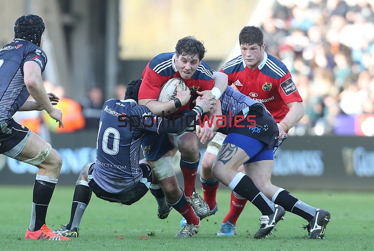 Munster flanker Dave O'Callaghan is stopped in his tracks by Ospreys pair Sam Davies and Matthew Dwyer.<br /> Guiness Pro12<br /> Ospreys v Munster<br /> Liberty Stadium<br /> 07.03.15<br /> ©Steve Pope - SPORTINGWALES
