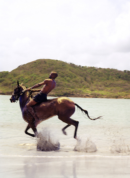 GROS -ISLET,ST.LUCIA : International Pony Club co-owner Alvin Phillipp rides a horse down Cas-En-Bas Beach. International Pony Club offers a fabulous sightseeing experience through pasturelands, along a natural forest trail to a most picturesque beach on the Atlantic coastline. Beausejour, Gros-Islet, St. Lucia, W.I.