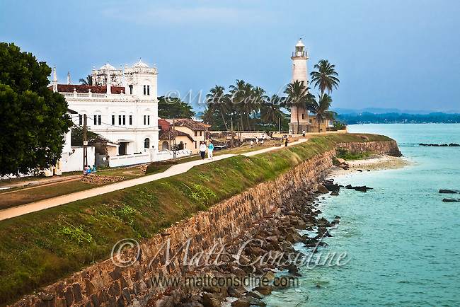 People stroll along the sea wall most afternoons.<br /> (Photo by Matt Considine - Images of Asia Collection)