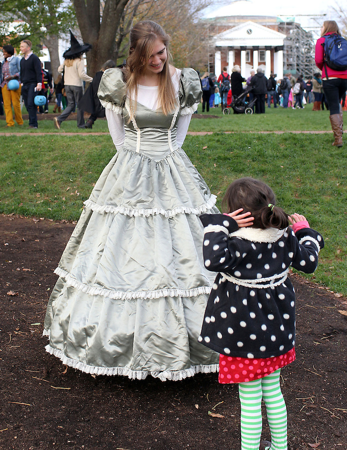 Ava Grey Shurtleff follows what she thinks is a princess Halloween on the lawn at the University of Virginia in Charlottesville, VA. Photo/Andrew Shurtleff