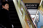 May 10, 2012, Tokyo, Japan - A business man goes up the escalator with Sony's logo in the distance inside BIC Camera in downtown Tokyo. Sony Corp. reports an annual net loss of 457 billion yen (approximately $5.7 billion US Dollars) in FY 2011. This is Sony's fourth year in a row of remaining in red, however, the company expects to return to net profit in FY 2012. (Photo by Yumeto Yamazaki/AFLO)