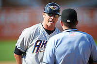 Akron RubberDucks manager Dave Wallace (17) asks home plate umpire Ryan Benson why he was thrown out of the game during the second game of a doubleheader against the Bowie Baysox on June 5, 2016 at Prince George's Stadium in Bowie, Maryland.  Bowie defeated Akron 12-7.  (Mike Janes/Four Seam Images)