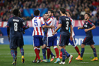 Atletico de Madrid´s Raul Garcia argues with Olympiacos´s N´Dinga during Champions League soccer match between Atletico de Madrid and Olympiacos at Vicente Calderon stadium in Madrid, Spain. November 26, 2014. (ALTERPHOTOS/Victor Blanco) /NortePhoto